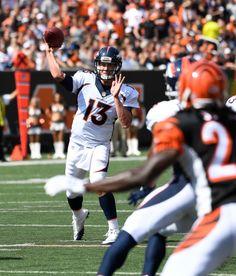 Denver Broncos quarterback Trevor Siemian (13) throws a pass to Demaryius Thomas during the first quarter against the Cincinnati Bengals September 25, 2016 at Paul Brown Stadium. John Leyba, The Denver Post