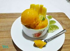 Mango Sorbet is the best way to cool down yourself on a hot summer day. It's creamy & refreshing; plus in a blender you can make mango sorbet in 5 min using 3 simple ingredients. Mango Sorbet, Summer Treats, Cantaloupe, Canning, Fruit, Breakfast, Simple, Hot, Desserts