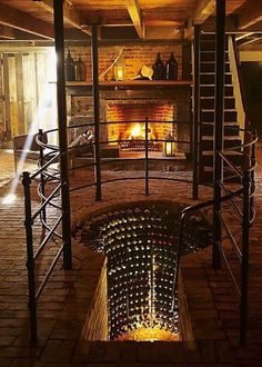Love the wine cellar. Great room. Add a library, music, chaise lounge and I so would want to enjoy a glass of wine. ♠ re-pinned by http://wfpcc.com/waterfrontpropertieslistings.php