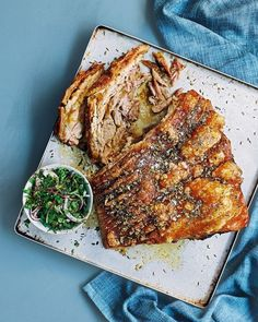 It's impossible to resist the crunchy-salty crackling and tender meat of slow-cooked pork belly. Cooked for six hours and served with zingy mint relish, this will be a hit for Sunday lunch and dinner parties alike. Pork Belly Recipes, Meat Recipes, Whole Food Recipes, Cooking Recipes, Best Pork Belly Recipe, Kale Recipes, Slow Cooking, Recipes Dinner, Cooking Tips