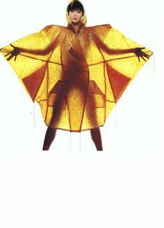 Comme des garcons yellow raincoat