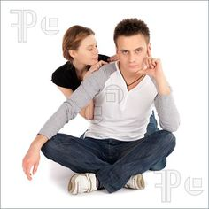 Pics of Young casual couple in love sitting on white isolated background