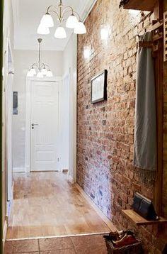love exposed brick hallway light fixtures