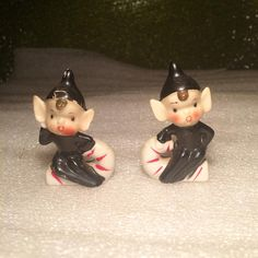 Here we have a Vintage Retro Pair of Pixie Elves Riding Candy Canes Figurines. They were made in the 1950s. They are Stamped Japan on the bottom. They are Hand Painted. They are a Superb set. Both are in Black Outfits and Both are sitting on Candy Canes. They take you back to your childhood