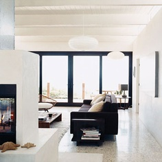Chic white fireplace.