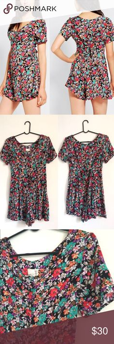 """90's Style UO Urban Renewal Floral Jumpsuit Urban Renewal by Urban Outfitters. This looks like it could have come straight out of the 90's. Seriously slap on a choker, some white keds, and a mini backpack and you are basically a character from My So Called Life. Floral romper with belted back for tighter closure. Button front. Great condition.   Length: 30.25"""" Bust: 34-36"""" Waist: 30"""" Hips: 40"""" Inseam: 5"""" Sleeve Length: 7.5"""" Urban Outfitters Pants Jumpsuits & Rompers"""