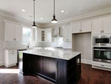 kitchen-with-white-cabinets-and-dark-island