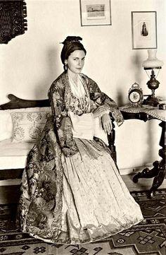 A Greek lady is wearing a traditional costume of Smyrna, Asia minor, now Turkey. Mykonos, Santorini, Paros, Greek Traditional Dress, Traditional Outfits, Greek Dress, Empire Ottoman, Greek Girl, Greek Fashion