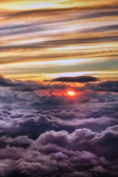 Globe Pics | Sunshine above the clouds