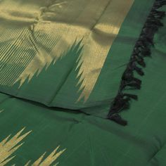 """The """"#Green"""" #handwoven #Kanjivaram #Silk #Sari from Kanakavalli is set off by a gold zari temple border on either side. An attractive gold zari adorn the green pallu. The border is repeated on the green blouse that completes the sari."""