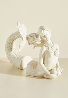Mermaid for Each Other Bookends. When that collection of classic maritime charts, adventure-filled nautical chronicles, and underwater fantasy novels begins to drift around your sea-themed study, youll be thrilled to spy this set of mermaid bookends swimming toward your bookshelf! #cream #modcloth