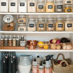 organized & labeled pantry shelves: baskets, jars & tray