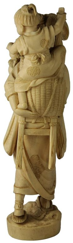 Ivory Carved Figure Group depicting a working mother bearing fruit & carrying her playful child in her basket. Stamp seal missing to the base. Height - 28cm