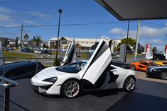McLaren Queensland Showroom, Australia. McLaren Gold Coast by Birchall & Partners Architects. Architects with extensive experience designing and building car showrooms since 1988. Architects Ipswich | Architects Brisbane | Architects Gold Coast Brisbane Architects, Bitcoin Miner, Southport, Gold Coast, Showroom, Australia, Building, Car, Automobile