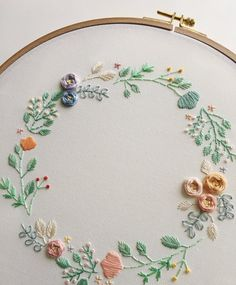 Custom Floral Wreath Embroidery Hoop Art All is hand embroidered using cotton embroidery floss on cotton. The fabric of this embroidery hoop art is ecru and hoop diameter is You can perso Garden Embroidery, Floral Embroidery Patterns, Embroidery Stitches Tutorial, Hand Embroidery Stitches, Embroidery Hoop Art, Hand Embroidery Designs, Embroidery Letters, Hand Work Embroidery, Cross Stitch Embroidery