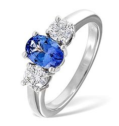 Tanzanite 7 x 5mm And Diamond 18K White Gold Ring - Item FET23-VY