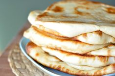 Naan – Indian Flatbread   Perfect naans - add a little grated garlic to the butter for extra flavor.