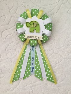 A personal favorite from my Etsy shop https://www.etsy.com/listing/261342965/mommy-to-be-ribbon-corsage-for-baby