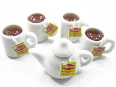 Great for your collection or made to charms for jewelery.    Material : Ceramic    Condition : 100% Brand New Quantity : 4 Tea Cups & 1 Tea Pot $7.99