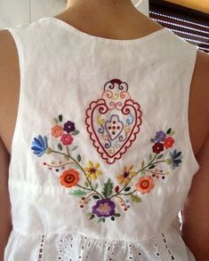 Folk Embroidery Ideas Magyar (hungarian) inspired - the center heart symbol is what defines a lot of the center motif of the sacred folk costumes of the Magyar's women embroidery Mexican Embroidery, Folk Embroidery, Embroidery Dress, Cross Stitch Embroidery, Embroidery Patterns, Machine Embroidery, Bordado Popular, Folk Fashion, Embroidered Clothes