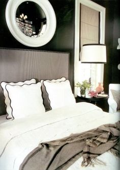 Theres something so sexy about a black walled bedroom with taupe and white accents.