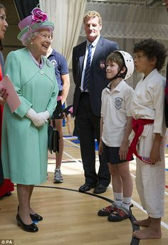 The Queen beamed as she met pupils at Westminster School and appeared to enjoy the fencing display almost as much as the racing