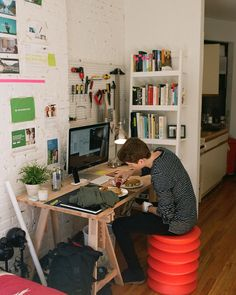"""""""Finn at home in NY. Apparently the chair helps tone your stomach muscles... Looks more like a traffic cone to me."""""""