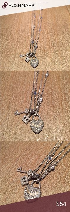Juicy Couture Silver Heart Necklace Juicy Couture Silver Heart Necklace with Jeweled double necklace. Two necklaces looped through a single heart pendent. A gorgeous piece to add to your collection!   💗Offers are welcome, just please use the offer button! Juicy Couture Jewelry Necklaces
