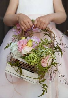 Flower girl basket with peonies, roses, lisianthus and hydrangeas.