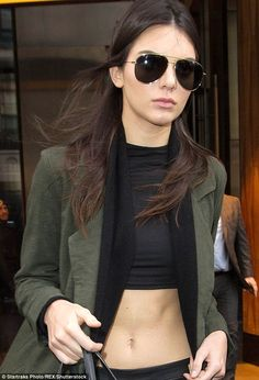 I;m sexy and I know it: The Keeping Up With The Kardashians star parted her hair in the middle like siblings Kourtney and Kim do so often, and added oversized aviator sunglasses, a favorite with sister Khloe