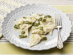 Giada tops homemade ravioli with a from-scratch pesto made with mint, parsley and basil.