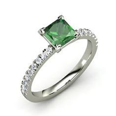 """PRINCESS COLLECTION - 14K White Diamond Emerald Ring.This seemingly marvelous ring has one central stunning eye clean Emerald Ring cutted in princess shape 1.38 carats.The white gold elegant setting of the ring adorns 18 brilliant diamonds, 0.012 each enhancing with its """"fire and brilliance"""" this chic creation.The total weight of the diamonds placed in the sides of the setting is 0.22ct.Diamond Clarity:SI1-2.Color:H.Cut:V.Good.Gold weight:3.0g.The creation is handmade.Certification:YES."""