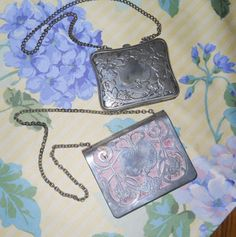 Two card cases with chains. Check out the picture of the one showing the inside. Judith Walker's Collection