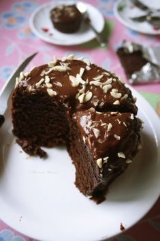 Best Ever Eggless Chocolate Cake recipe with step-by-step photos. Quick and easy to make cake for all chocolate lovers. Eggless cakes was never in my to-do list and why should it be? I love EGG! and we love EGG! And imagining a cake without egg … Eggless Chocolate Cake, Eggless Desserts, Eggless Recipes, Eggless Baking, Chocolate Muffins, Best Chocolate, Chocolate Recipes, Easy Desserts, Chocolate Chip Cookies