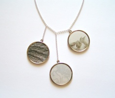 This one-of-a-kind necklace is adorned with framed photos. $49.00