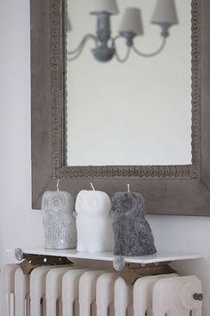 wish I knew where to get these owl candles....love the colors...hard to find gray