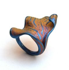 Anodized titanium and other colored metals can be a great source of inspiration for polymer art. Jose Marin's colorful metalsmithing is the subject of today's blog from The Polymer Arts magazine. www.thepolymerarts.com