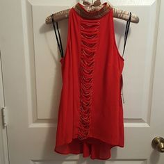 XOXO red blouse. This is beautiful  red shirt with gold beads details around  the  neck, and also some more details in front of it. The shirt is high low high neck with 2 buttons a little opening detail on the back. It's New with tags size XS. XOXO Tops Blouses