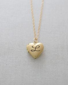Engraved Heart Locket Necklace in silver, gold or rose gold by Olive Yew. A beautiful and classic engraved heart locket necklace. Create a personalized gift perfect for you or your loved one.