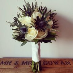 A classic Scottish thistle, heather and avalanche rose bouquet.