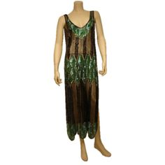 Tunic: 1920's, French, sequined and beaded cotton net.