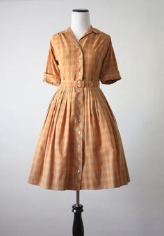 1950's pumpkin plaid dress -- a pair of white Keds, and it's off to taking care of the house for the morning.  Love this look.