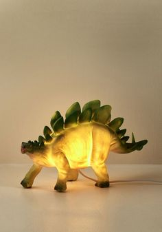 Home Décor - This plastic LED lamp is so stylish, you'll be left in awe of it's cretaceous charms! This green dino makes the perfect prehistoric pal to your quirky decor, and when this splendid stegosaurus begins Suspension Bar, Side Table Styling, Quirky Decor, Rustic Kitchen Design, Decoration Originale, Bedroom Lamps, Kids Bedroom, Nursery Lamps, Bedroom Ideas