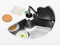 This sink is AWESOME. You put your dishes in one side then turn it and the back becomes a dishwasher!