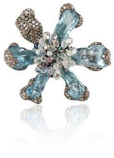 "Arunashi Aquamarine Wild-Orchid Ring.  Aquamarine 42.870 carats, 31 Multi Sapphires 19.32 carats, 221 Diamonds 4.860 carats, 2 1⁄4"" x 2 1⁄4"""