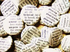 Buttons covered with pieces of an old dictionary each featuring a romantic word . . .