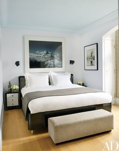 A photograph by Florian Maier-Aichen is flanked by sconces from Circa Lighting in a guest room. | archdigest.com