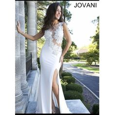 JOVANI formal dress prom I only wore this once. It has a bustle. It is in great condition. Dry cleaned. Cups built in so you don't have to wear a bra. Sheer. Jovani runs small. I am usually a 2 or 4 but the 6 was perfect. Jovani Dresses