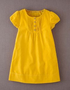 The idea of a yellow chOOp dress seized me. The Oliver + S family reunion dress in yellow baby cord like this might work well.