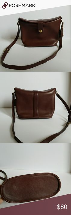 Brown Vintage Coach Leather Bucket Bag w Push Lock Beautiful quality authentic bag. Leather is soft and I only looks better with age. 8 inch height 11 inch width 4.5 inch depth Coach Bags Crossbody Bags